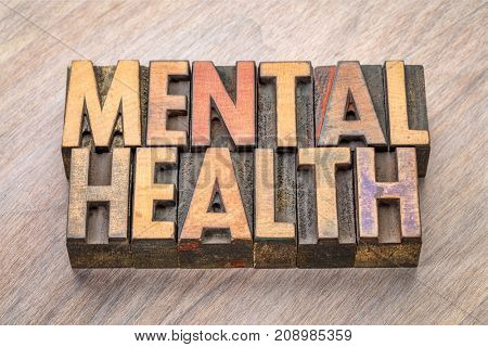 mental health -word abstract in vintage wood letterpress printing blocks