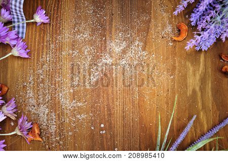 Authentic horizontal wooden background with empty space for text and fresh meadow flowers