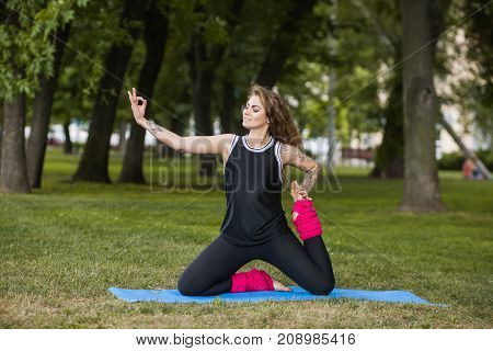 Creative yoga exercises. Strong body. Confidence in life, modern sport outdoors, nature background. Beautiful youth lifestyle, pretty and happy young girl workout in park