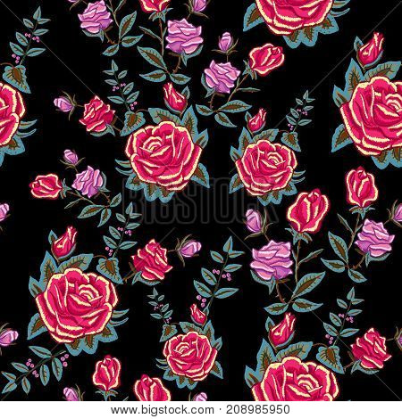 Embroidery traditional seamless pattern with red roses. Vector embroidered floral patch  with flowers for clothing design.