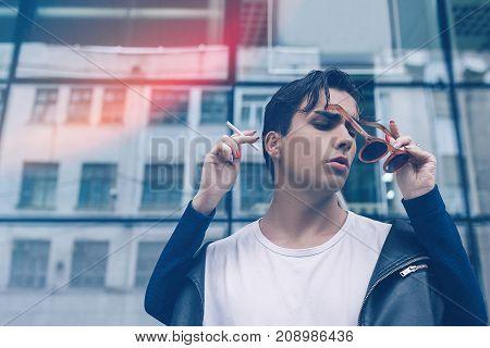 man social smoking drug addiction bad habit youth fashion lifestyle cancer concept