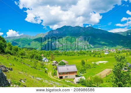 In A Picturesque Valley Among The Mountains There Is A Small Village.