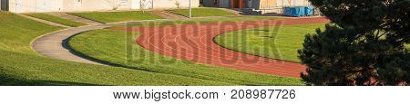 Red Running sprint race lane in stadium panoramic