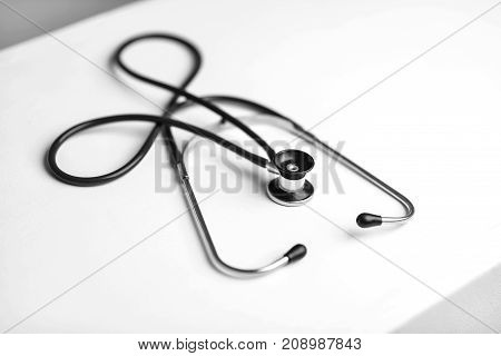 Stethoscope on a table in a doctor's office black and white poster