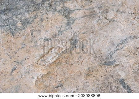 Texture of the stone surface. Natural orange gray marble stone.