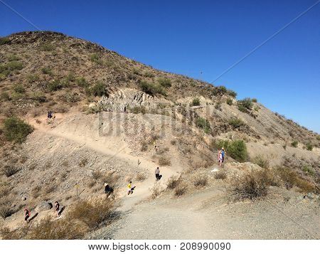 PHOENIX AZ USA - OCTOBER 15 2017: Phoenicians hiking in North Mountain Park during cozy cool early morning hours