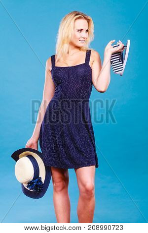 Woman Wearing Dress Holding Sun Hat An Flip Flops