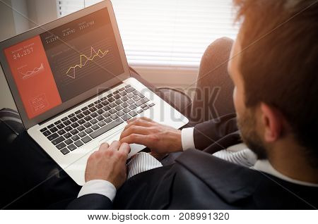 Businessman Using Laptop With Bank Account On Screen