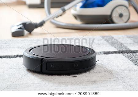 Robotic Vacuum Cleaner Working On Carpet