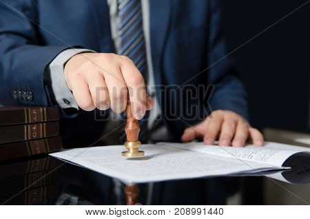 Lawyer stamps contract notary public businessman agreement. law attorney lawyer business contract court judge courtroom concept