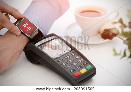 Mobile payment in cafe with smart watch nfc near field communication wireless technology