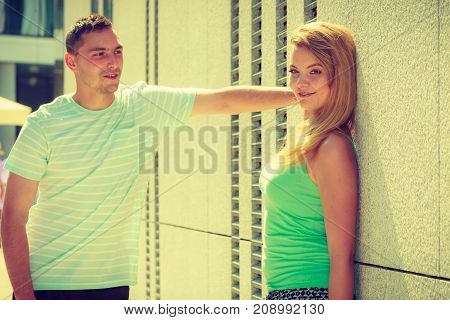Man Flirting With Girl On City Street