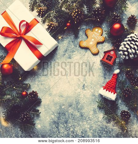 Christmas Background, Gift Box With Red Ribbon, Fir Branches,toys,decoration,pine Cone, String Of Li