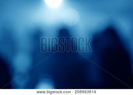 Blurred background of light spots in a nightclub
