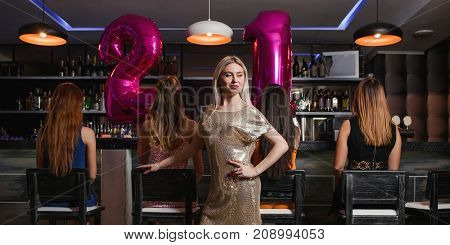 Female 21 birthday party in night club. Young women company in bar, unrecognizable friends. Beautiful model, celebration together, beauty concept