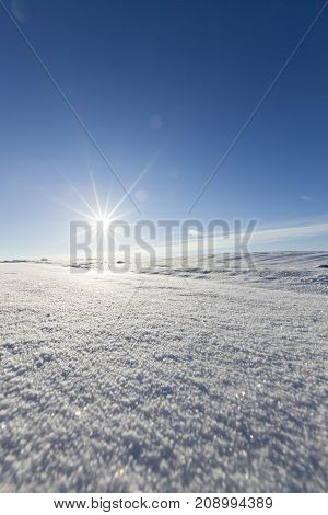 photo with white snow after the snowfall in the winter season.