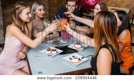 Birthday party celebration. Happy toast. Youth company in cafe with drinks. Modern leisure time, good friends together, festivity concept