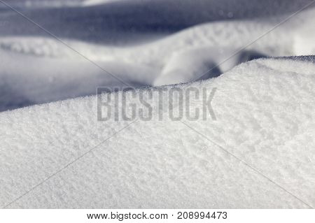 snow drifts, illuminated by sunlight in winter frosty time. close-up photo