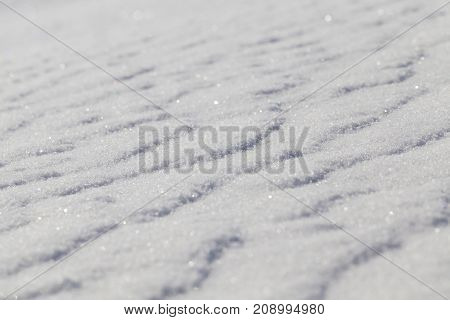 beautiful surface of snow, formed by the wind. winter close-up photo