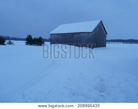 Snowy barn in Northern New York at Dusk