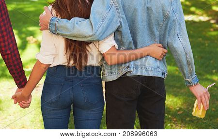 Friendship love jealousy adultery polygamy concept. Love triangle. Young woman in relationship with two men.