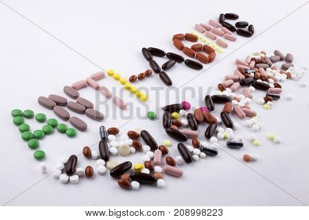 Hand Writing Text Caption Inspiration Medical Care Concept Written With Pills Drugs Capsule Word Sto
