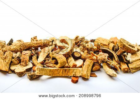 Dried Chinese Herbs Placed on White Background. Copy Space on Top.