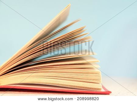 Opened Book, Lying On A Wooden Background With Toning