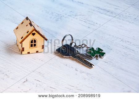 The little house next to it is the keys. Symbol of hiring a house for rent selling a home buying a home a mortgage