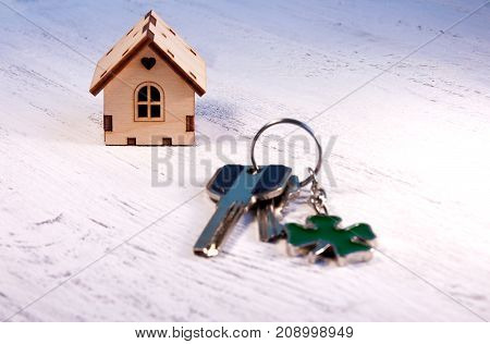 The Little House Next To It Is The Keys. Symbol Of Hiring A House For Rent, Selling A Home, Buying A