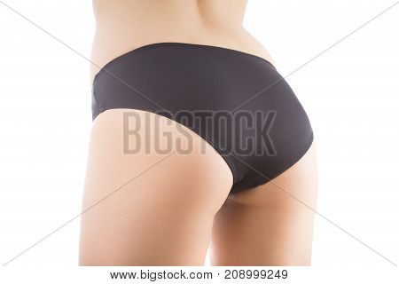 beautiful female buttocks in black panties isolated on white