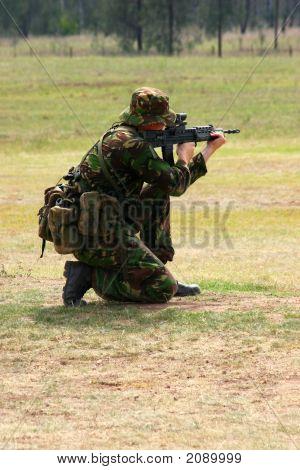 Firing A Rifle On The Range