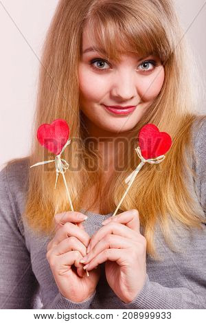 Cheerful Girl Fooling With Hearts.