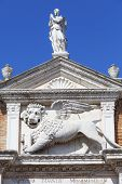 Venetian Arsenal old shipyard stone lion Venice Italy. Construction of the Arsenal began in the 12th century it was the largest industrial complex in Europe before the Industrial Revolution poster