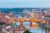 River Arno and famous bridge Ponte Vecchio at twilight from Piazzale Michelangelo in Florence, Tuscany, Italy poster