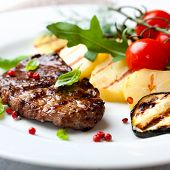Gourmet grilled steak flavoured with pink pepper and basil poster