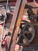 Gears cogs and wheels on an antique thresher poster