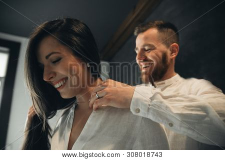 Girl Is Gathering For A Walk. Husband Is Waiting For Wife. Female Is Preparing For A Date. Dressing
