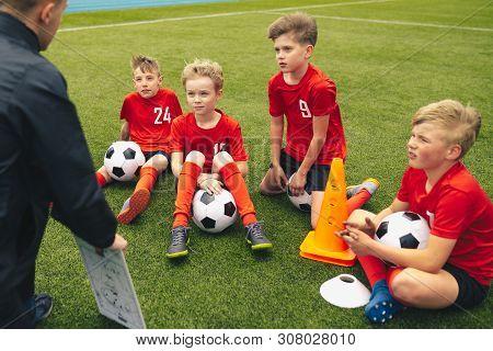 Football Coach Coaching Children. Soccer Football Training Session For Children. Young Coach Teachin
