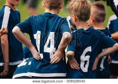 Children In Soccer Team. Young Boys Standing In A Team With Coach. Close-up Of Football Team Standin