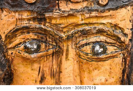 Wooden Sculpture In The Park In The Shape Of Face With A Mustache, Brown Wooden Sculpture, Eyes From
