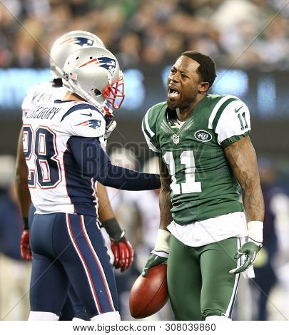 EAST RUTHERFORD, NJ - NOV 22: New York Jets wide receiver Jeremy Kerley (11) speaks to New England Patriots strong safety Steve Gregory (28) after a play at MetLife Stadium on November 22, 2012.
