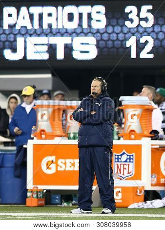 EAST RUTHERFORD, NJ - NOV 22: New England Patriots head coach Bill Belichick stands on the sidelines against the New York Jets at MetLife Stadium on November 22, 2012 in East Rutherford, New Jersey.