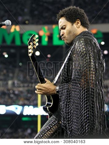 EAST RUTHERFORD, NJ - NOV 22: Recording artist Lenny Kravitz performs during half time at the game between the New York Jets and New England Patriots at MetLife Stadium on November 22, 2012.