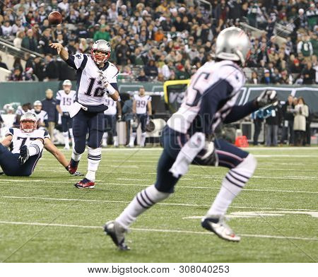 EAST RUTHERFORD, NJ - NOV 22: New England Patriots quarterback Tom Brady (12) throws a pass to wide receiver Brandon Lloyd (85)against the New York Jets at MetLife Stadium on November 22, 2019.