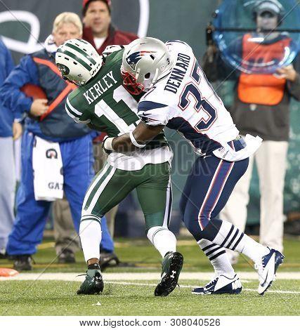 EAST RUTHERFORD, NJ - NOV 22: New York Jets wide receiver Jeremy Kerley (11) is tackled by New England Patriots cornerback Alfonzo Dennard (37) at MetLife Stadium on November 22, 2012.