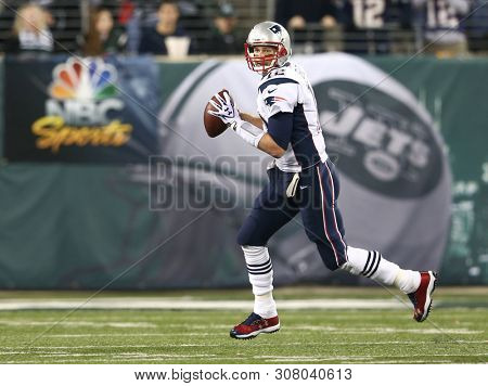 EAST RUTHERFORD, NJ - NOV 22: New England Patriots quarterback Tom Brady (12) looks to pass the ball against the New York Jets at MetLife Stadium on November 22, 2012 in East Rutherford, New Jersey.