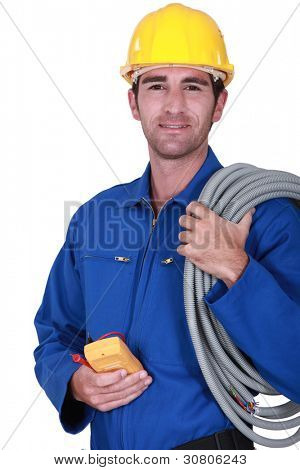 Electrician with voltmeter in hand