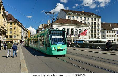 Basel, Switzerland - April 17, 2019. Green Tram On The Bridge Mittlere Bruecke. City Of Basel, Switz