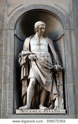 FLORENCE, ITALY - JANUARY 11, 2019: Nicola Pisano, statue in the Niches of the Uffizi Colonnade in Florence, Italy